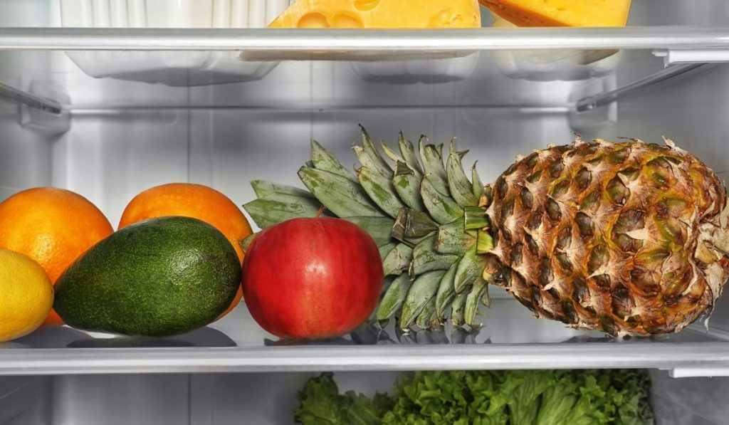 avocado and other fruits in the fridge