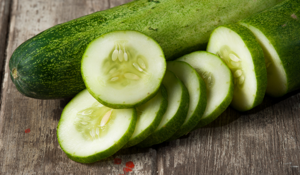Close-up photo of cucumber and sliced cucumber on a table
