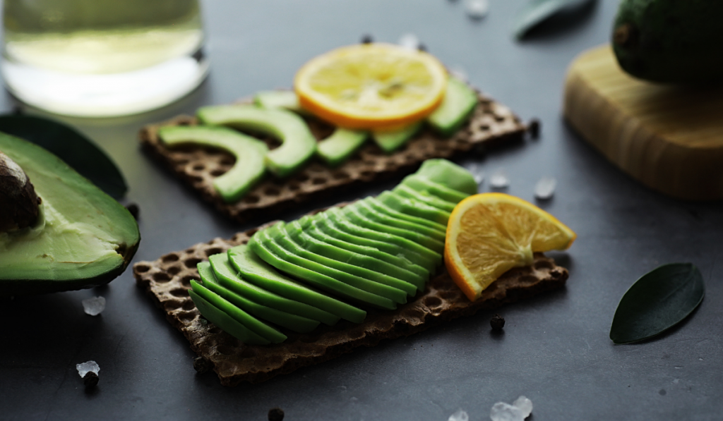 thinly sliced avocados with sliced lemons on top